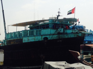 An aqua painted dhow loaded for Iran.
