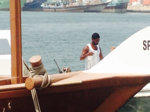 A sailor on one of the speedier Sharjah craft.
